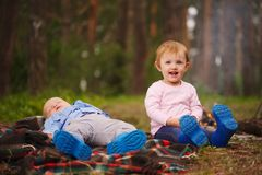 Happy children hiking in the forest Stock Image