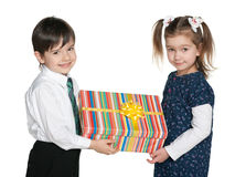 Happy children hold a gift box Stock Images