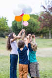 Happy children holding balloons Royalty Free Stock Photos