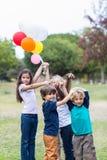Happy children holding balloons Royalty Free Stock Photo
