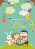 Happy children holding a basket of Easter eggs Stock Photos