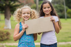 Happy children holding blank Royalty Free Stock Image