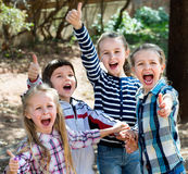 Happy  children holding hands and giving friendship Stock Photo