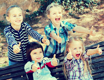 Happy  children holding hands and giving friendship Royalty Free Stock Photography