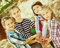 Happy  children holding hands and giving friendship. Swear Royalty Free Stock Photos