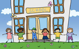 Happy children holding for hands near school stock images