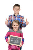 Happy children holding a slate. On white background Stock Image