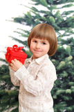 Happy children holds red box with bowknot Stock Images