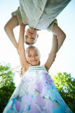Happy children hugging bottom view Royalty Free Stock Photos