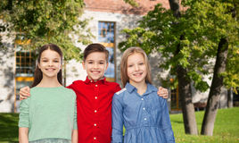 Happy children hugging over summer campus Royalty Free Stock Photo