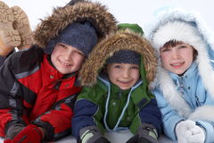 Happy children in jackets Stock Images