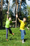 Happy children jumping. In the summer outdoors Royalty Free Stock Images