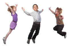 Happy children jumping. Happy and smiling children jumping, over white Royalty Free Stock Image