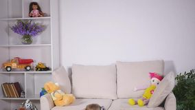 Happy children jumping on the bed and having fun.  stock video footage