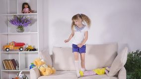 Happy children jumping on the bed and having fun. slow motion.  stock video footage