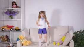 Happy children jumping on the bed and having fun. slow motion.  stock video