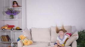 Happy children jumping on the bed and having fun. slow motion.  stock footage