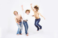 Happy children jumping. Happy brothers jumping on white background Stock Photo
