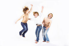 Happy children jumping stock photos