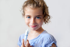 Almost happy children kid girl with medicine Stock Image