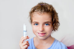 Almost happy children kid girl with medicine Stock Photography