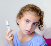Almost happy children kid girl with syringe Royalty Free Stock Images