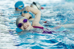 Free Happy Children Kids Group At Swimming Pool Class Learning To Swim Stock Photos - 95802113