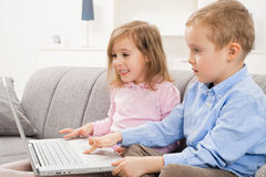 Happy children with laptop Stock Photography