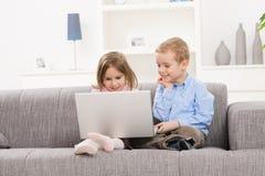 Happy children with laptop stock photo