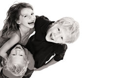 Happy children laughing and looking up royalty free stock image