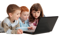 Happy children learning on kids notebook computer