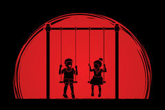 Happy Children, Little boy and girl are playing swing together Royalty Free Stock Photo