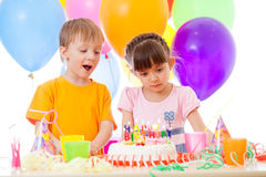 Happy children look at birthday cake Royalty Free Stock Image