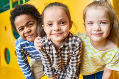 Happy Children Looking at Camera in Play Center stock image