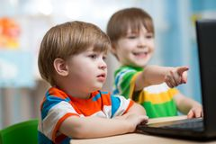 Happy children looking at laptop Royalty Free Stock Photo