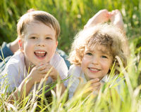 Happy children lying on grass Stock Photography