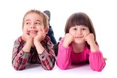Happy children lying on white Stock Photos