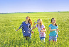Happy children making bubbles Royalty Free Stock Photo