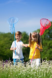 Happy children on meadow Stock Photos