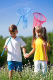 Happy children on meadow Stock Images