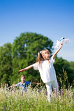 Happy children on meadow. Happy boy and little girl with plane on a meadow in a sunny day Royalty Free Stock Photos