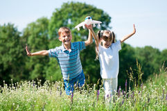 Happy children on meadow Stock Photography