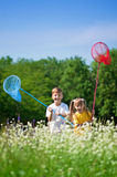 Happy children on meadow stock photo