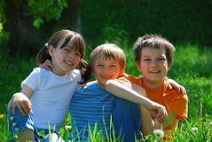 Happy children in meadow Royalty Free Stock Image