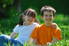 Happy Children in Meadow Stock Image