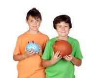 Happy children with money-box Stock Photos