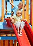 Children move out to slide in playground Royalty Free Stock Photography