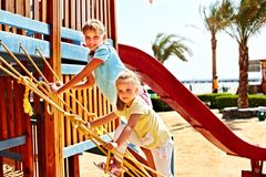 Children move out to slide in playground. Royalty Free Stock Images