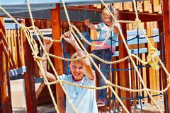 Children move out to slide in playground. Happy children move out to slide in playground Royalty Free Stock Images