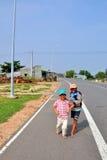 Happy children in mui ne vietnam. Two happy children in mui ne vietnam with lovely actions stock image
